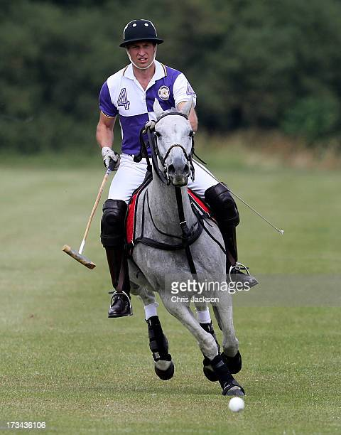 Prince William Duke of Cambridge takes part in The Jerudong Trophy at Cirencester Park Polo Club on July 14 2013 in Cirencester England