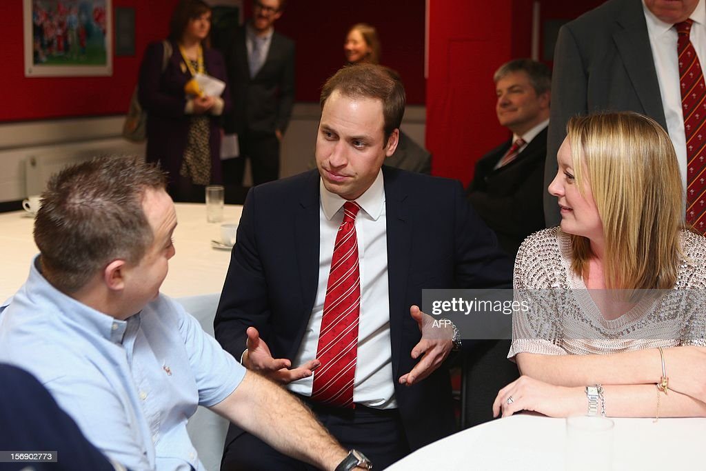 Prince William, Duke of Cambridge talks beneficiaries of the Charitable Trust which supports injured players in Wales, ahead of the Autumn International rugby match between Wales and New Zealand at the Millennium Stadium, Cardiff on November 24, 2012 in Cardiff, Wales. AFP PHOTO/POOL/Michael Steele