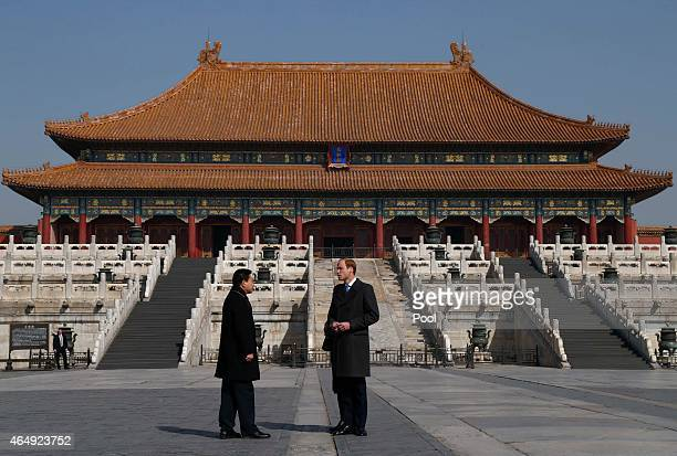 Prince William Duke of Cambridge talks to a Chinese museum officer during a visit to the Forbidden City on March 2 2015 in Beijing China The Duke of...