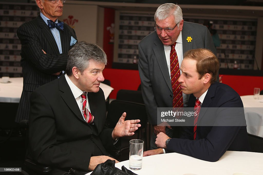 Prince William, Duke of Cambridge talks to a former player and beneficiary of the Charitable Trust which supports injured players in Wales, ahead of the Autumn International rugby match between Wales and New Zealand at the Millennium Stadium, Cardiff on November 24, 2012 in Cardiff, Wales.