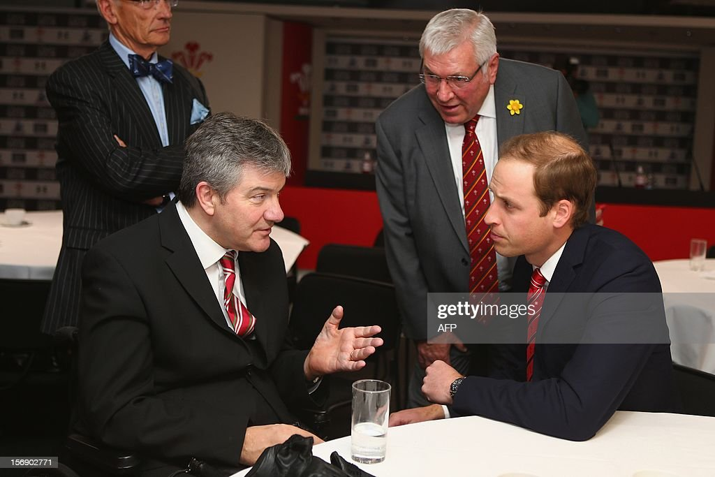 Prince William, Duke of Cambridge talks to a former player and beneficiary of the Charitable Trust which supports injured players in Wales, ahead of the Autumn International rugby match between Wales and New Zealand at the Millennium Stadium, Cardiff on November 24, 2012 in Cardiff, Wales. AFP PHOTO/POOL/Michael Steele