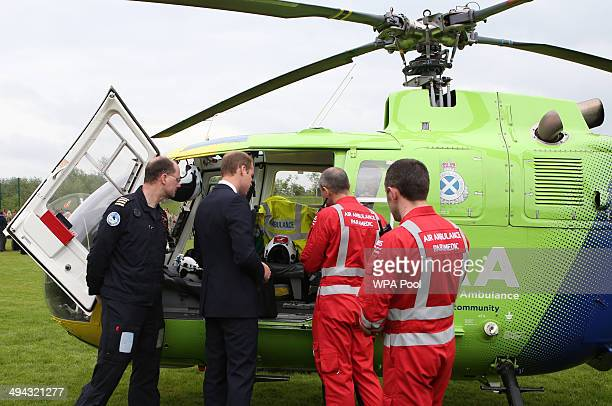 Prince William Duke of Cambridge talks to Air Ambulance staff during a visit to Strathearn Community Campus on May 29 2014 in Crieff Scotland The...