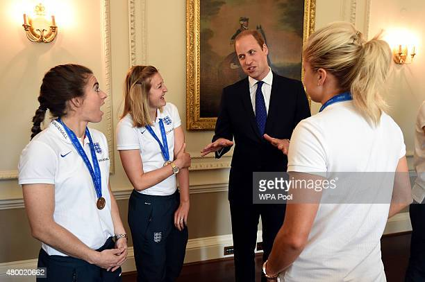 Prince William Duke of Cambridge talks to England's Karen Carney Ellen White and captain Stepeh Houghton as he meets members of the England Women's...