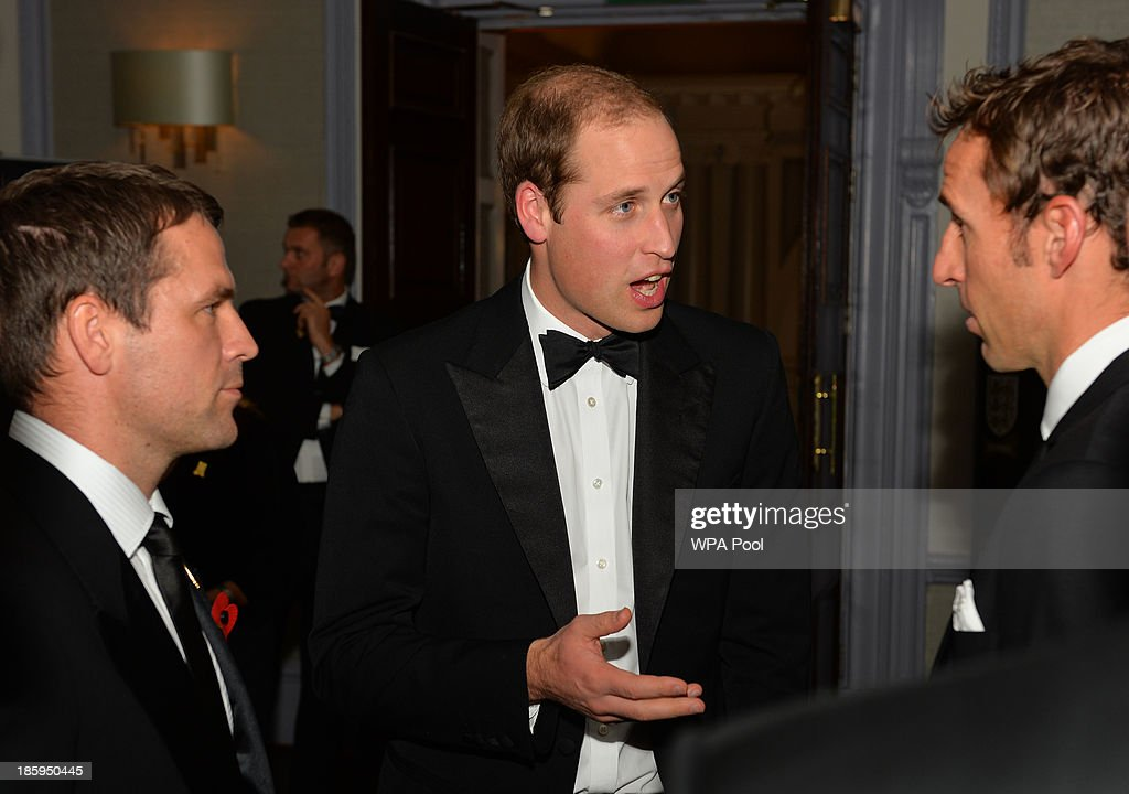 <a gi-track='captionPersonalityLinkClicked' href=/galleries/search?phrase=Prince+William&family=editorial&specificpeople=178205 ng-click='$event.stopPropagation()'>Prince William</a>, Duke of Cambridge (C) talks to former England players <a gi-track='captionPersonalityLinkClicked' href=/galleries/search?phrase=Gareth+Southgate&family=editorial&specificpeople=206903 ng-click='$event.stopPropagation()'>Gareth Southgate</a> (R) and Michael Owen (L) as he attends The Football Association's 150th Anniversary Gala Dinner at the Grand Connaught Rooms on October 26, 2013 in London, England. The Duke of Cambridge is president of the Football Association, which was founded 150 years ago on October 26, 1863. The event marks the day when a group of men representing a dozen London and suburban clubs met at the Freemason's Tavern in London, to draw up the rules of a sport that went on to become the most popular in the world.
