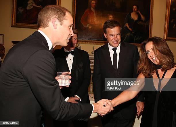 Prince William Duke of Cambridge talks to guests including Peter Jones and wife Tara during the Tusk Trust conservation charity 25th Anniversary Ball...