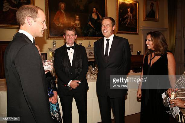 Prince William Duke of Cambridge talks to guests including Peter Jones during the Tusk Trust conservation charity 25th Anniversary Ball which honours...