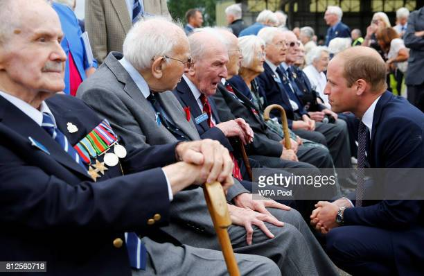 Prince William Duke of Cambridge talks to veteran George 'Johnny' Johnson during a visit to The Battle Of Britain Memorial Flight to mark it's 60th...
