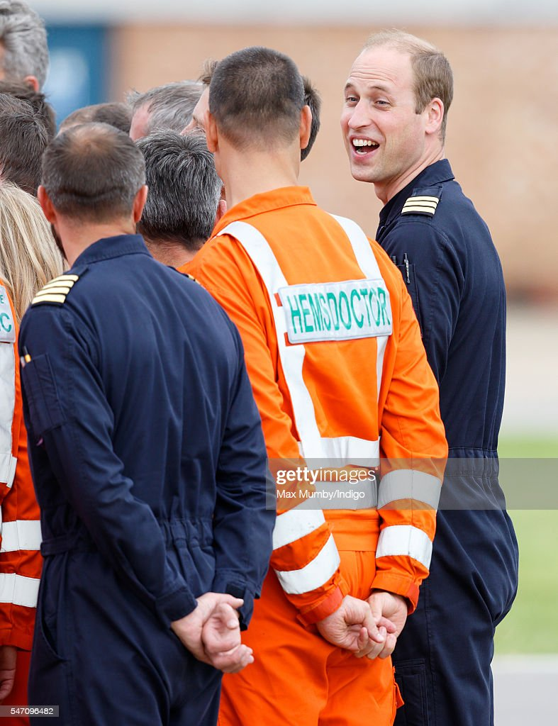 Prince William, Duke of Cambridge talks with air ambulance personnel as he attends the opening, by Queen Elizabeth II, of the East Anglian Air Ambulance base at Cambridge Airport on July 13, 2016 in Cambridge, England.