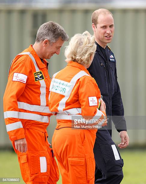 Prince William Duke of Cambridge talks with air ambulance personnel as he attends the opening by Queen Elizabeth II of the East Anglian Air Ambulance...