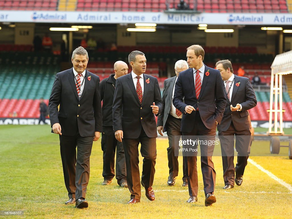 Prince William, Duke of Cambridge (R) talks with Chairman of the WRU David Pickering and Chief Executive Roger Lewis during the Autumn International between Wales and South Africa at the Millennium Stadium on November 9, 2013 in Cardiff, Wales.