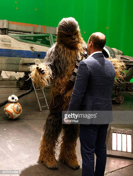 Prince William Duke of Cambridge talks with Chewbacca during a tour of the Star Wars sets at Pinewood studios on April 19 2016 in Iver Heath England...