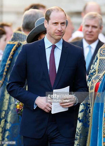 Prince William Duke of Cambridge talks with choir boys as he attends the Commonwealth Observance Day Service at Westminster Abbey on March 14 2016 in...
