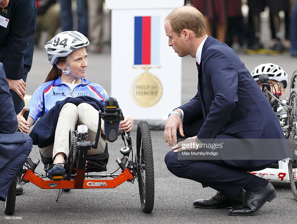Prince William, Duke of Cambridge talks with Corporal Claire Edwards who is taking part in the 2013 Hero Ride on a recumbent hand bike as he and Prince Harry attend the opening of the new Help for Heroes Recovery Centre at Tedworth House on May 20, 2013 in Tidworth, England. During their visit the two Royal Princes met with wounded veterans, serving personnel, and their families. Tedworth House in Wiltshire is one of four new units in England which will offer respite care and rehabilitation to injured and sick service personnel, veterans and their families.