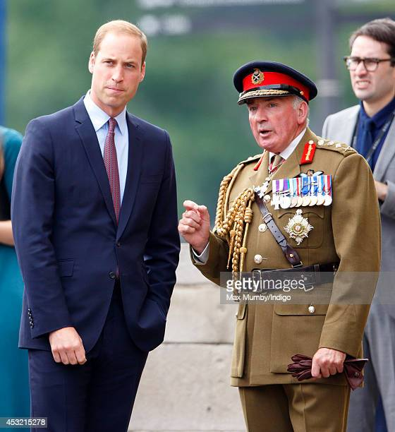 Prince William Duke of Cambridge talks with General the Lord Dannatt Constable of the Tower of London as he visits the poppy field art installation...