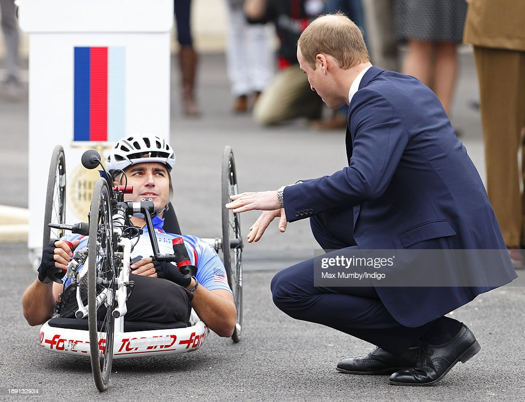 Prince William, Duke of Cambridge talks with injured US veteran Corporal Charlie Lemon who is taking part in the 2013 Hero Ride on a recumbent hand bike as he and Prince Harry attend the opening of the new Help for Heroes Recovery Centre at Tedworth House on May 20, 2013 in Tidworth, England. During their visit the two Royal Princes met with wounded veterans, serving personnel, and their families. Tedworth House in Wiltshire is one of four new units in England which will offer respite care and rehabilitation to injured and sick service personnel, veterans and their families.