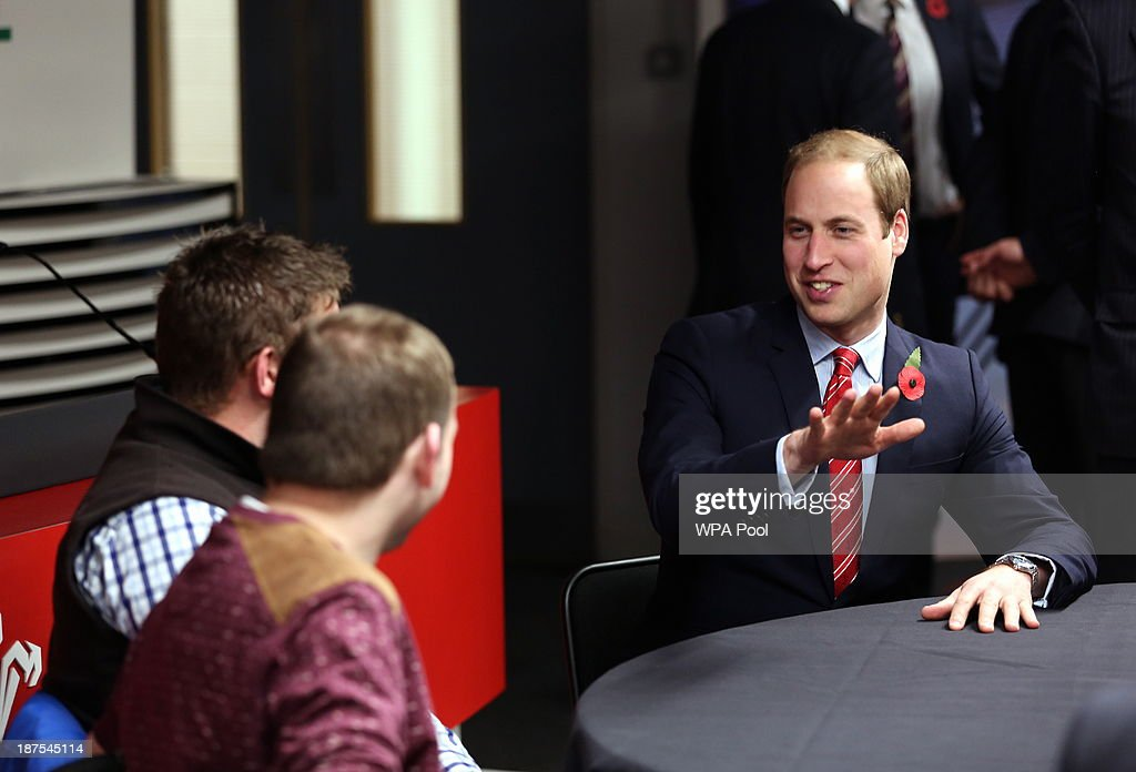 Prince William, Duke of Cambridge (R) talks with injured WRU players in the Ray Gravell Room coach during the Autumn International between Wales and South Africa at the Millennium Stadium on November 9, 2013 in Cardiff, Wales.