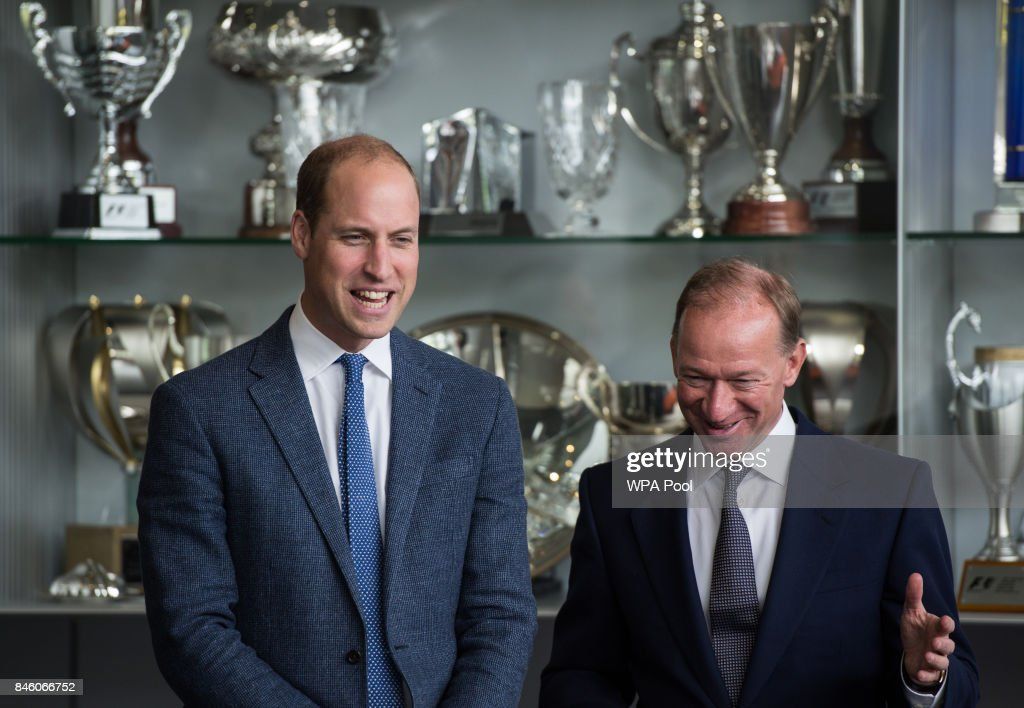 Prince William, Duke of Cambridge talks with Mike Flewitt (R), CEO of McLaren Automative in front of a trophy cabinet for McLaren racing sports achievements during a visit to McLaren Automotive at McLaren Technology Centre on September 12, 2017 in Woking, England.