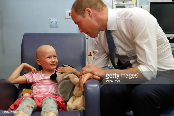 Prince William Duke of Cambridge talks with patient Daisy Wood during a visit to the Royal Marsden hospital on May 16 2017 in Sutton England The Duke...