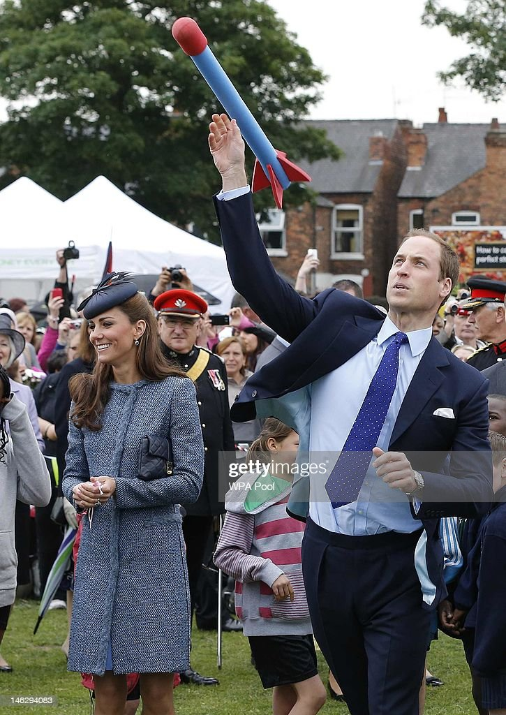 <a gi-track='captionPersonalityLinkClicked' href=/galleries/search?phrase=Prince+William&family=editorial&specificpeople=178205 ng-click='$event.stopPropagation()'>Prince William</a>, Duke of Cambridge throws a foam javelin as part of a children's sports event as his wife <a gi-track='captionPersonalityLinkClicked' href=/galleries/search?phrase=Catherine+-+Duchess+of+Cambridge&family=editorial&specificpeople=542588 ng-click='$event.stopPropagation()'>Catherine</a>, Duchess of Cambridge looks on while visiting Vernon Park during a Diamond Jubilee visit to Nottingham on June 13, 2012 in Nottingham, England.