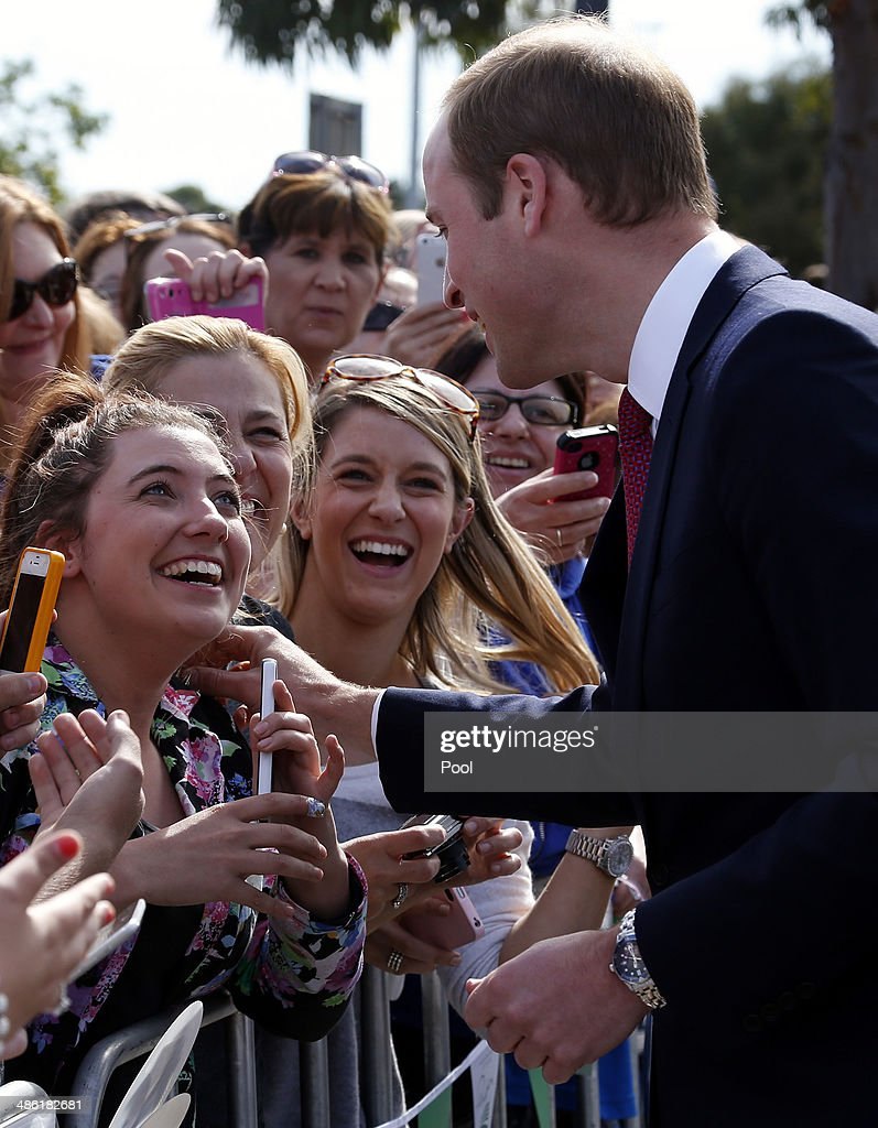 Prince William, Duke of Cambridge touches a women's jacket as he greets members of the crowd with his wife Catherine, Duchess of Cambridge, at the Playford Civic Centre in the Adelaide suburb of Elizabeth on April 23, 2014 in Adelaide, Australia. The Duke and Duchess of Cambridge are on a three-week tour of Australia and New Zealand, the first official trip overseas with their son, Prince George of Cambridge.