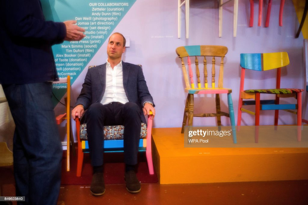 Prince William, Duke of Cambridge tries out a finished chair, which was restored as part of the theraputic process during a visit to the Spitalfields Crypt Trust in St Leonard's Church, Shoreditch on September 19, 2017 in London, England. The trust aims to provide a holistic recovery service for those dealing with complex drug and alcohol addictions.