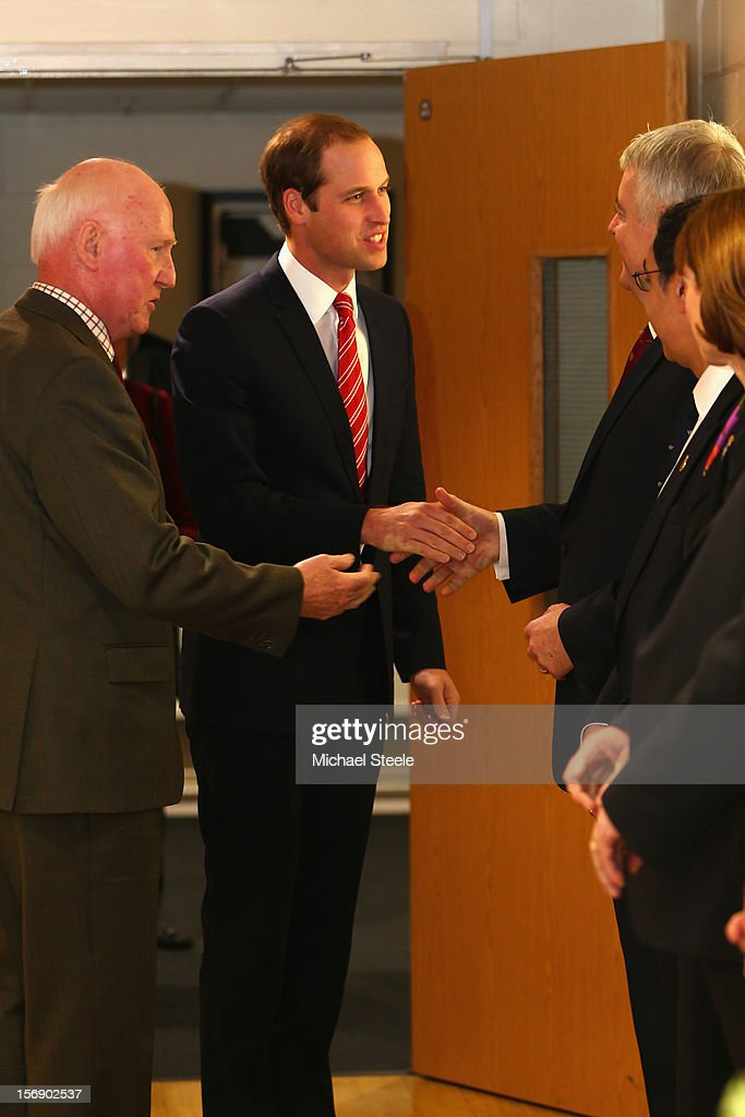 Prince William, Duke of Cambridge (C) Vice Patron of the Welsh Rugby Union is introduced to the First Minister of Wales Carwyn Jones (R) ahead of the Autumn International rugby match between Wales and New Zealand at the Millennium Stadium, Cardiff on November 24, 2012 in Cardiff, Wales.