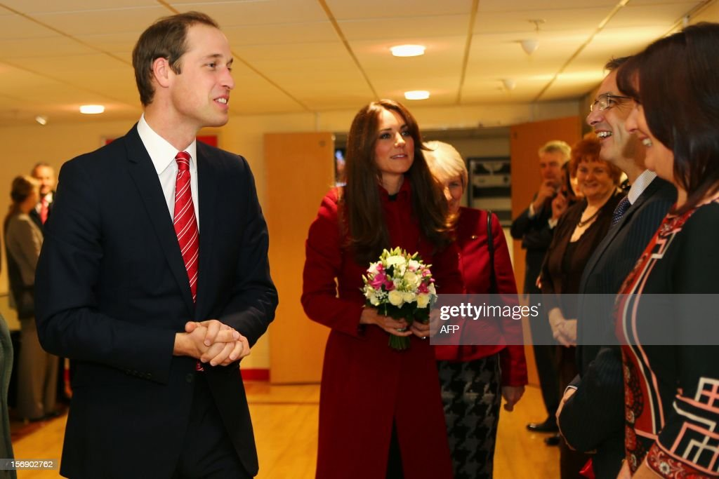 Prince William, Duke of Cambridge (L) Vice Patron of the Welsh Rugby Union and Catherine, Duchess of Cambridge (C) attend the Autumn International rugby match between Wales and New Zealand at the Millennium Stadium, Cardiff on November 24, 2012 in Cardiff, Wales. AFP PHOTO/POOL/Michael Steele