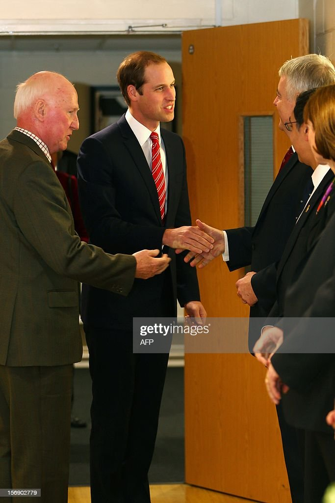 Prince William, Duke of Cambridge (C) Vice Patron of the Welsh Rugby Union is introduced to the First Minister of Wales Carwyn Jones (R) ahead of the Autumn International rugby match between Wales and New Zealand at the Millennium Stadium, Cardiff on November 24, 2012 in Cardiff, Wales. AFP PHOTO/POOL/Michael Steele