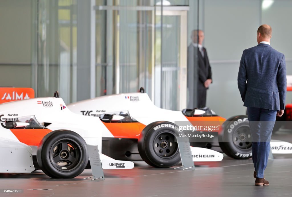 Prince William, Duke of Cambridge views some McLaren Formula One racing cars as he visits McLaren Automotive at the McLaren Technology Centre on September 12, 2017 in Woking, England.