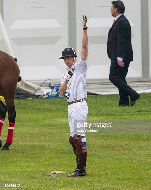 Prince William Duke of Cambridge warms up before playing in the Audi Polo Challenge at Chester Racecourse on May 29 2013 in Chester England