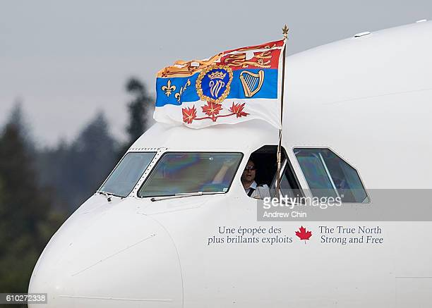 Prince William Duke of Cambridge's flag flys out of the pilot's window of the plane carrying Prince William Duke of Cambridge Catherine Duchess of...