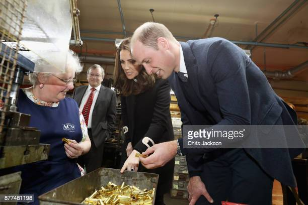 Prince William Duke of Cambrige and Catherine Duchess of Cambridge inspect whistles as they visit Acme Whistles in Birmingham on November 22 2017 in...