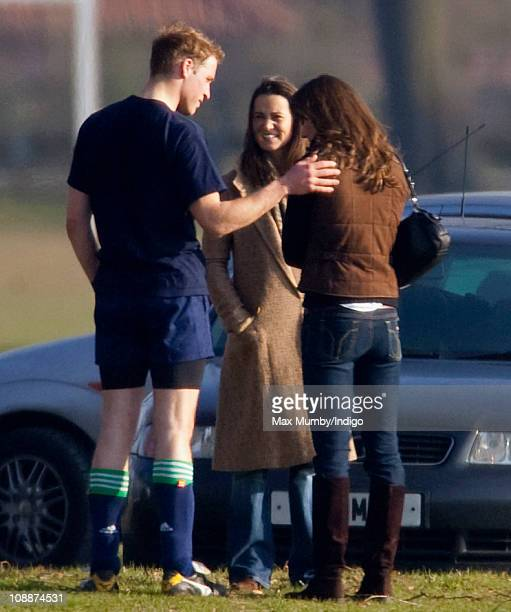 Prince William embraces Kate Middleton as her sister Pippa Middleton looks on after playing the Field Game in an old boys match at Eton College on...
