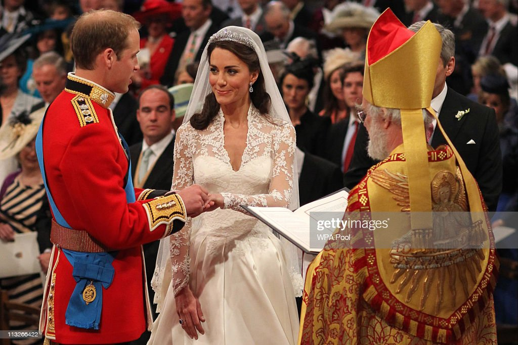 Prince William exchanges rings with his bride Catherine Middleton in front of the Archbishop of Canterbury, <a gi-track='captionPersonalityLinkClicked' href=/galleries/search?phrase=Rowan+Williams&family=editorial&specificpeople=239468 ng-click='$event.stopPropagation()'>Rowan Williams</a> inside Westminster Abbey on April 29, 2011 in London, England. The marriage of Prince William, the second in line to the British throne, to Catherine Middleton is being held in London today. The marriage of the second in line to the British throne is to be led by the Archbishop of Canterbury and will be attended by 1900 guests, including foreign Royal family members and heads of state. Thousands of well-wishers from around the world have also flocked to London to witness the spectacle and pageantry of the Royal Wedding.