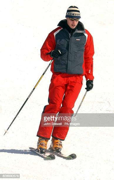 Prince William following close behind his father the Prince of Wales as he hurtles down the Madrisa ski slopes above the Swiss village of Klosters...