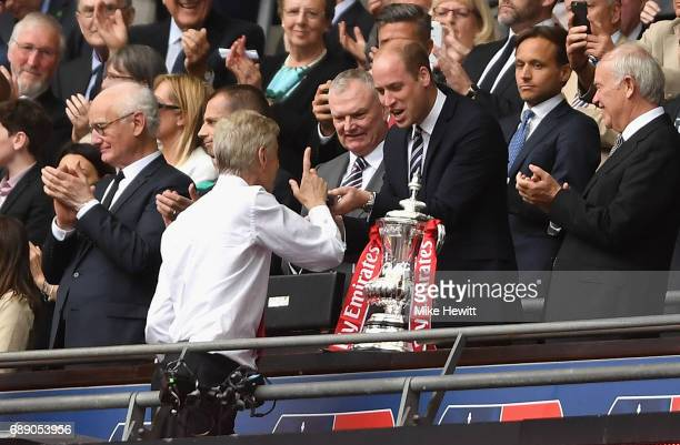 Prince William gives Arsene Wenger Manager of Arsenal his winners medal after The Emirates FA Cup Final between Arsenal and Chelsea at Wembley...