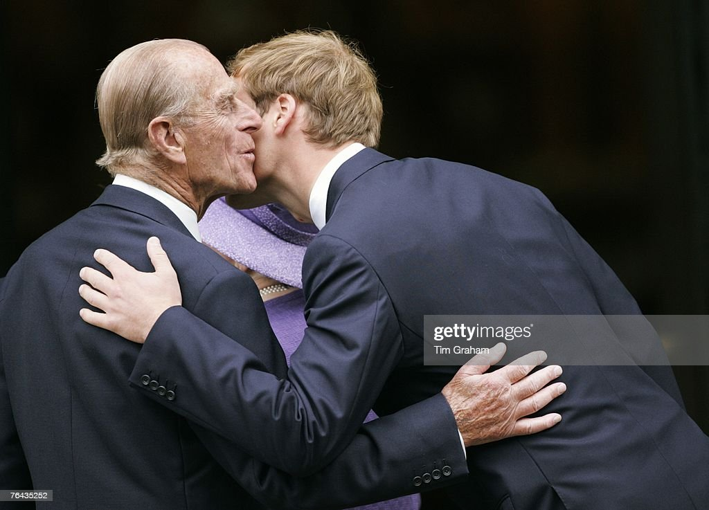 Prince William greets his grandfather Prince Philip, Duke of Edinburgh at the 10th Anniversary Memorial Service for their mother Diana, Princess of Wales at Guards Chapel at Wellington Barracks on August 31, 2007 in London, England.