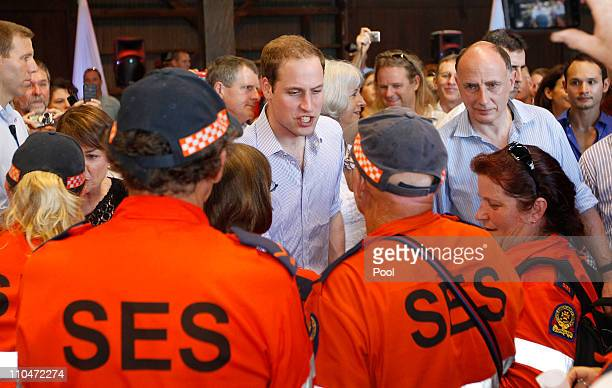 Prince William greets members of the State Emergency Services at the Cruise Liner Terminal on March 19 2011 in Cairns Australia Prince William is in...