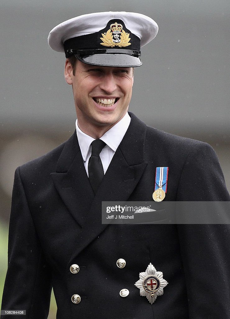 Prince William hands out silver and gold pins to sailors at HMNB Clyde naval base on October 28, 2010 in Faslane, Scotland. The presentation ceremony was held at Faslane , recently named as the future home of Britains submarine services.