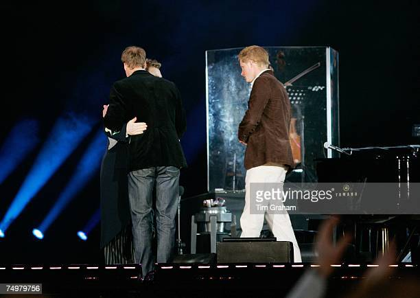 Prince William hugs Sir Elton John as he and Prince Harry end the show by saying thanks to all who took part in the 'Concert for Diana' at Wembley...
