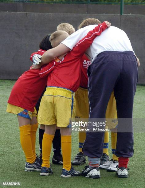Prince William in a huddle with schoolchildren as he plays football alongside youngsters during a visit to the FA's HatTrick Project at West Gate...