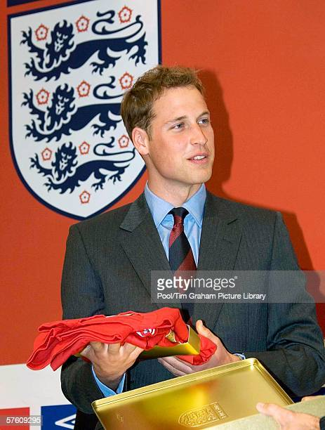 Prince William in his new role as President of the Football Association receives limited edition England football shirts at FA Cup Final on May 13...