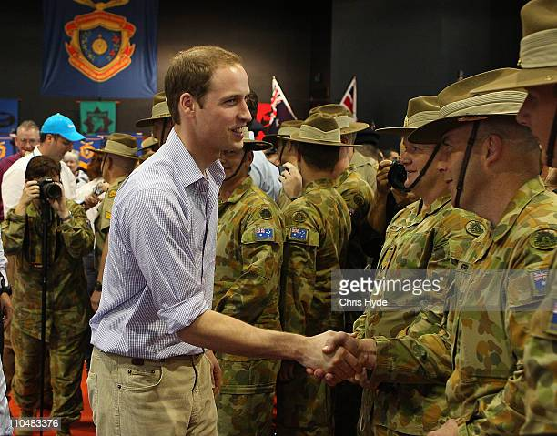 Prince William is greeted by members of The Australia Army during a visit to West Moreton Anglican College on March 20 2011 in Ipswich Brisbane...