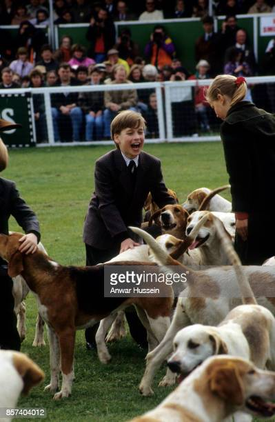 Prince William laughs as he meets hounds during a visit to the Badminton Horse Trials on May 10 1991 in London England
