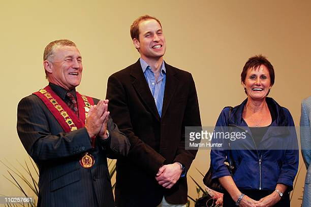 Prince William laughs with Mayor of Greymouth Tony Kokshoorn and his wife Lynne Kokshoorn during his visit to Shantytown on March 17 2011 in...