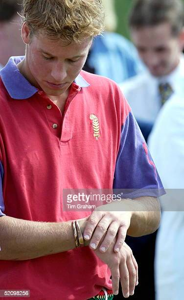 Prince William Looking Down At His Wrist Which May Be Sore After His Team Highgrove Won Their Match The Prince Is Wearing Two Coppper Bracelets On...