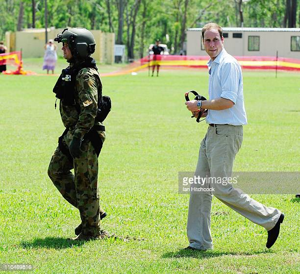 Prince William looks back to the crowd before flying out of Cardwell on a Blackhawk helicopter on March 19 2011 in Cardwell Australia His Royal...