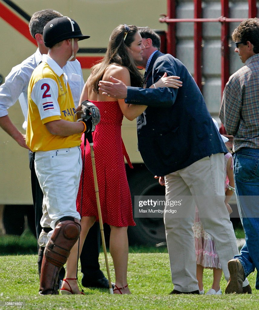 Prince William looks on as Kate Middleton kisses his Private Secretary Jamie Lowther-Pinkerton as they attend the Chakravarty Cup charity polo match at Ham Polo Club on June 17, 2006 in Richmond, England.