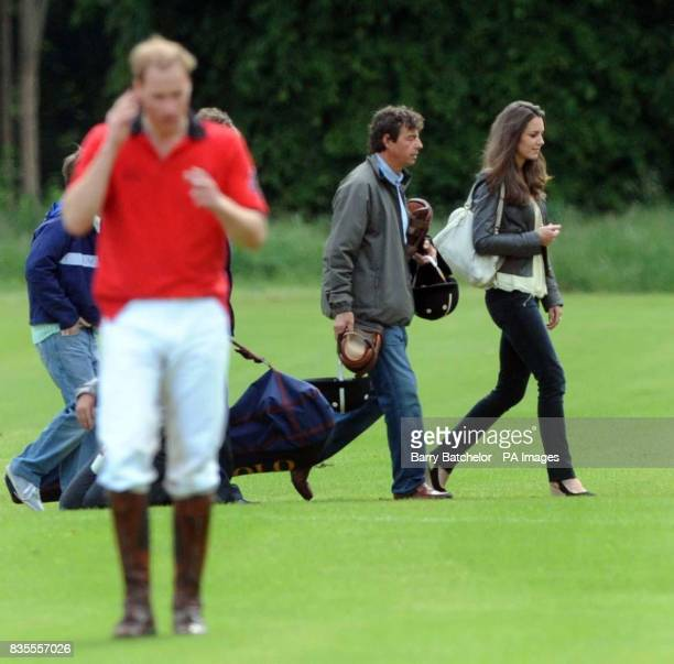 Prince William makes for the presentation ceremony as Kate Middleton walks away after watching him play in the Dorchester Trophy at the Cirencester...