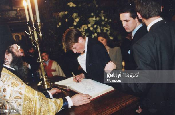 Prince William older son of Britain's Prince of Wales signs the christening book for his first godson Prince Konstantine Alexios son of Crown Prince...